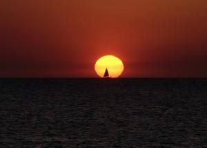 Solace sailing at sunset